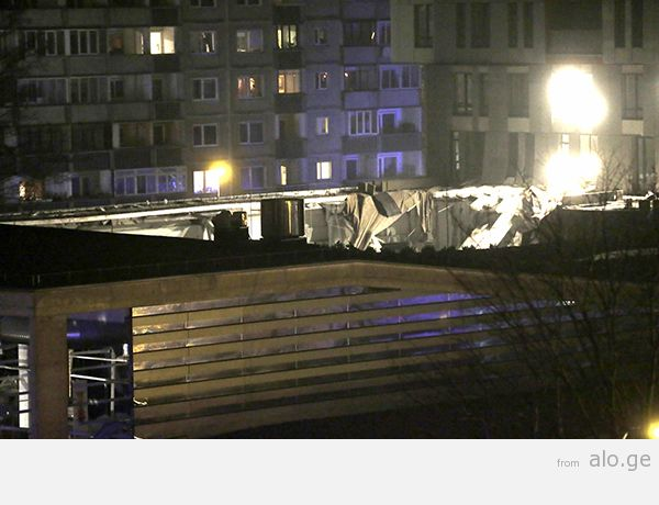 The collapsed roof of a store is pictured in Riga