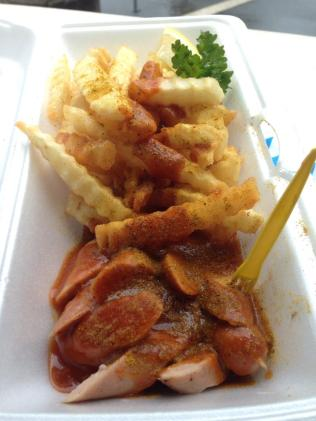 fries and a miniature fork with currywurst. Freshly made!!