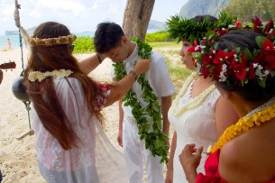 Giving a Lei to the groom