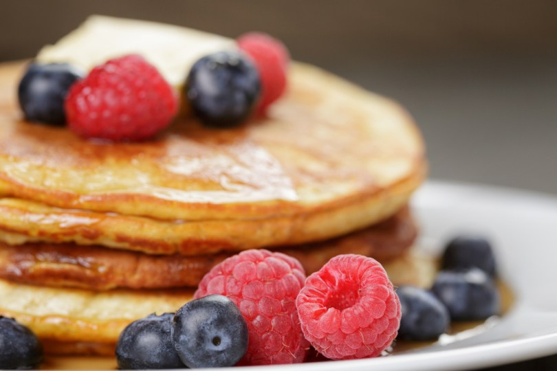 Pancakes with raspberry, blueberry and maple syrup