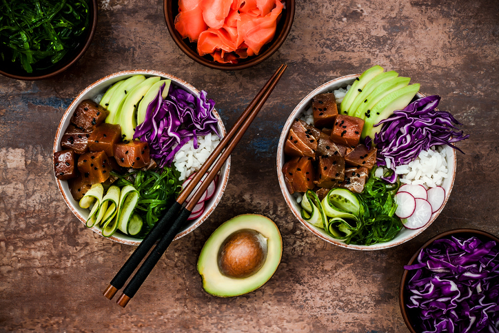 Hawaiian tuna poke bowl with seaweed, avocado, red cabbage, radishes