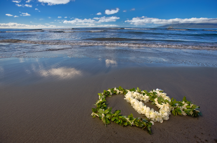Heart shaped flower lei and garland on beach
