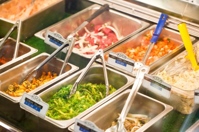 Poke and side dish galore at your local grocery in Hawaii.