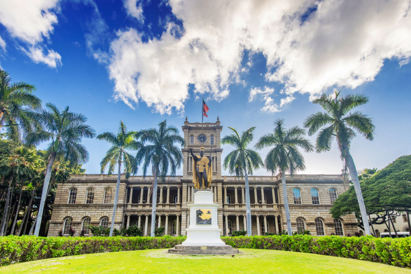 After the Iolani Palace tours, head across the street to the Kamehameha statue.
