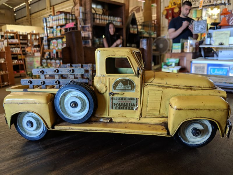 """An old school toy truck showing it's branded """"old sugar mill"""" sticker can be found near the entrance of the old Waialua sugar mill."""