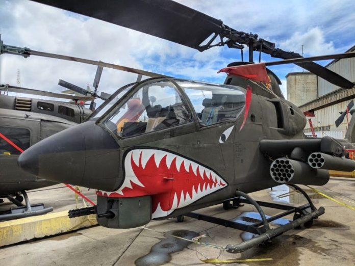 Pacific Aviation Museum's AH-1 Cobra attach helicopter with menacing teeth.