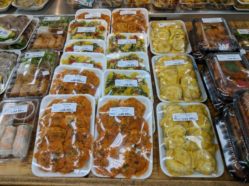 Saranwrapped side dishes and bentos (boxed lunches) are yummy at Palama super market.