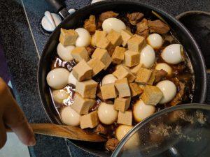 Add eggs and deep-fried tofu.
