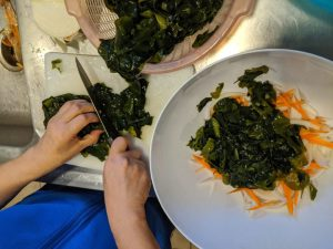 Cut the wakame salad ingredients.