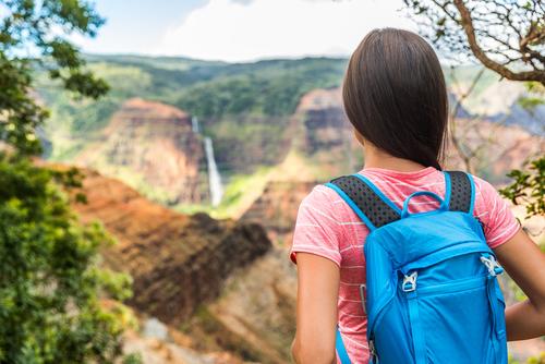 Hiking to the waterfall on the Waipoo Falls Trail in Kauai.