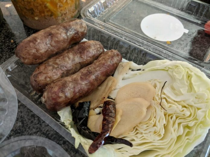Thai sausages have a sour taste that matches so well with ginger and cabbage.