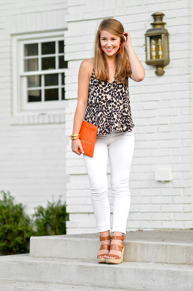 leopard halter top, leopard top, cheetah halter top, cheetah print, leopard print, orange tassel earrings, lisi lerch tassel earrings, gigi new york clutch, orange clutch, white jeans, southern style, preppy girl style