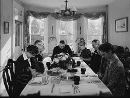 Early picture of Family at Dinner Table