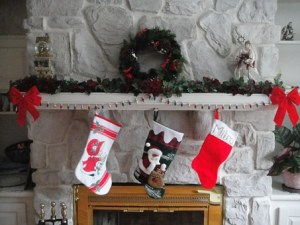 Christmas stockings are hung by the fireplace