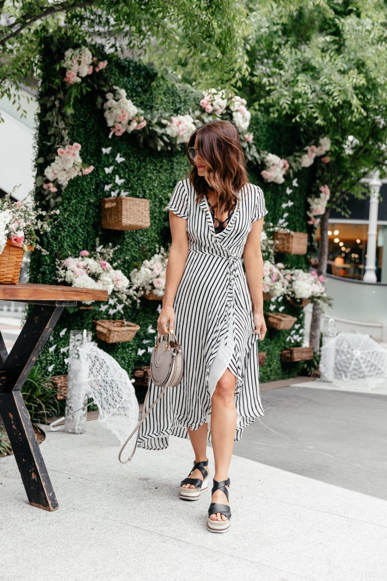 Dallas lifestyle blogger A Lo Profile wearing a black and white striped maxi dress with wedges and a black lace bralette