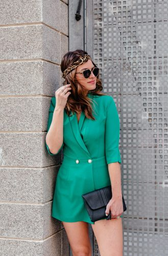 A Lo Profile wearing an emerald green blazer romper by River Island with a leopard headband with a black Gigi New York tassel clutch and Tony Bianco lace up heels with black Dior sunglasses