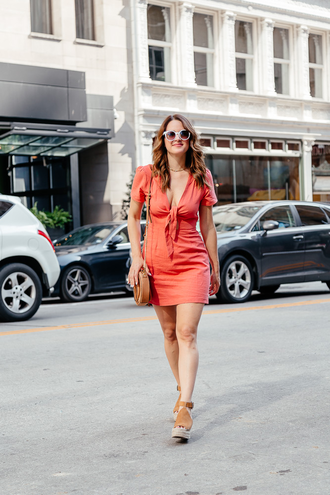 Lauren Roscopf of A Lo Profile wearing an orange tie dress and talking about incorporating color into your summer wardrobe.