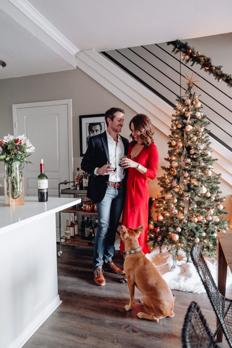 Couple with dog and Christmas Decor