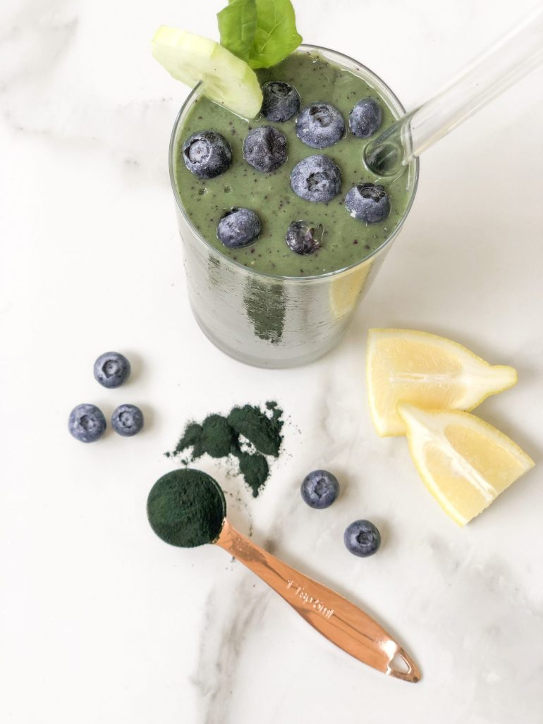 An easy, delicious, & nutrient packed Whole 30 approved spirulina smoothie recipe including coconut water, banana, spinach, avocado, spirulina & more.
