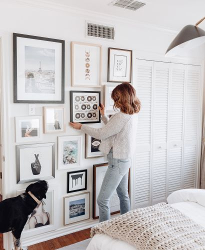 Sharing my tips on how to create a gallery wall in your home including easy to follow steps, how we did ours, & some of my favorite prints or frames.