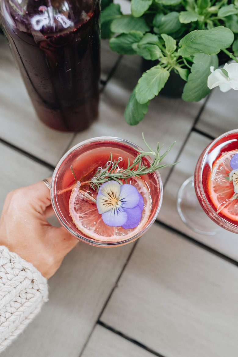 Sharing an easy to make fun & festive pansy holiday cocktail recipe featuring Cool Wave Pansies & a delicious blackberry cordial.