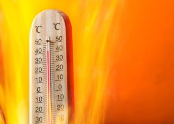 Celsius thermomether with fire flames, hot weather.
