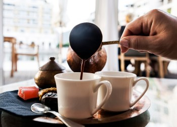 Turkish Coffee is pouring in coffee cup