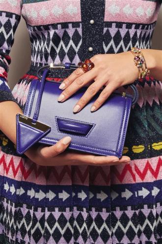 Dress: Mary Katrantzou Bag: Loewe Ring: Pomellato Bracelet: Randa Tabbah