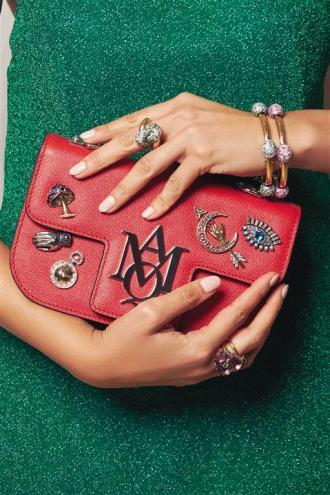 Dress: Delpozo Bag: Alexander McQueen Jewelry: Pomellato
