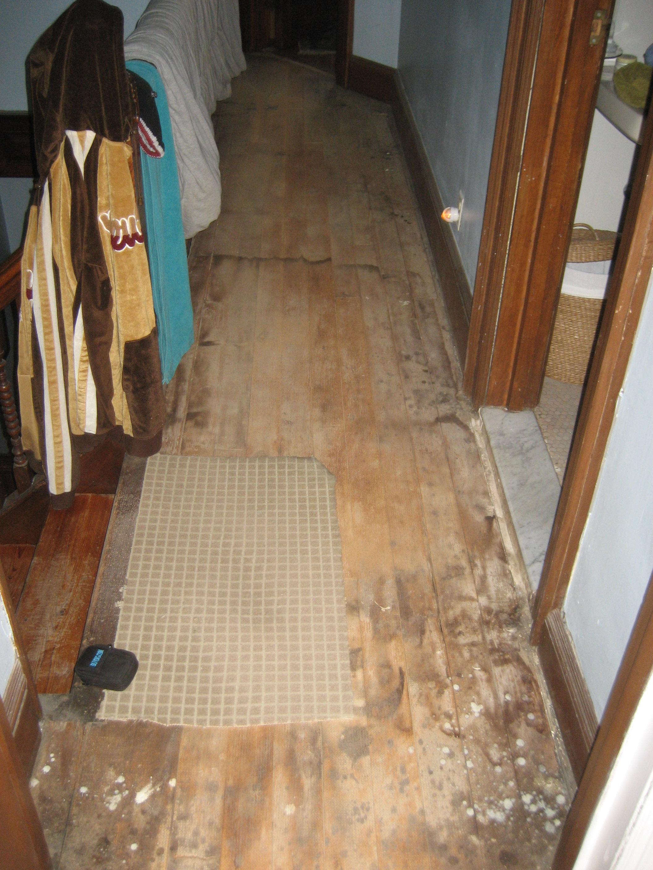 Before Picture of Hallway Floor