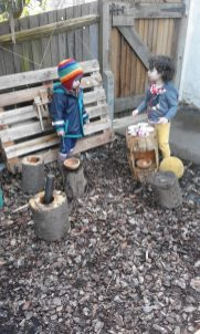 Outdoor sensorial exploration in mud kitchen