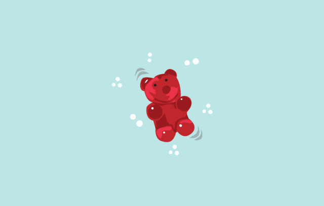 illustration of a gummy bear on a light blue background intended to demonstrate the size of a fetus at the 8 week mark