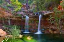 Double Falls in Zion National park is a beautiful 20 foot waterfall into a green natural pool.