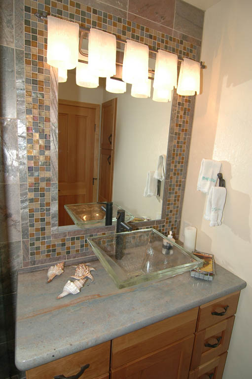 Vessel Sink Granite Countertop and Slate Mosaic Tile Frame