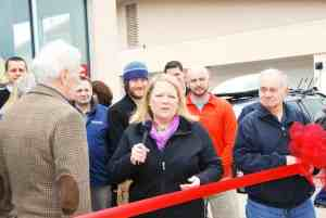 Owner Lisa Hollenbeck addresses the crowd at the ribbon cutting ceremony for Alpine Shop O'Fallon's Grand Opening celebration on Friday, March 22.
