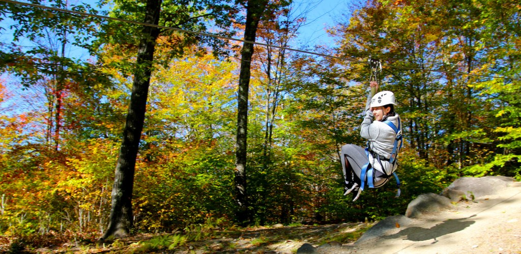 Girl on Zipline in the Fall