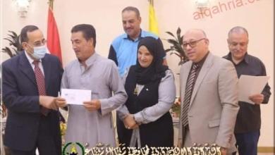 صورة محافظ شمال سيناء يوزع الدفعة الأولي من تعويضات أسر الشهداء والمصابين