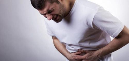 هل مغص المعدة من علامات الحمل