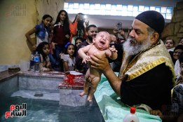 64782-صور-احد-التناصير-تعميد-الاطفال-(4)