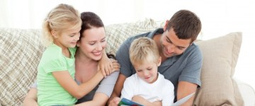 family_parents_child_read_book_together_learn_happy