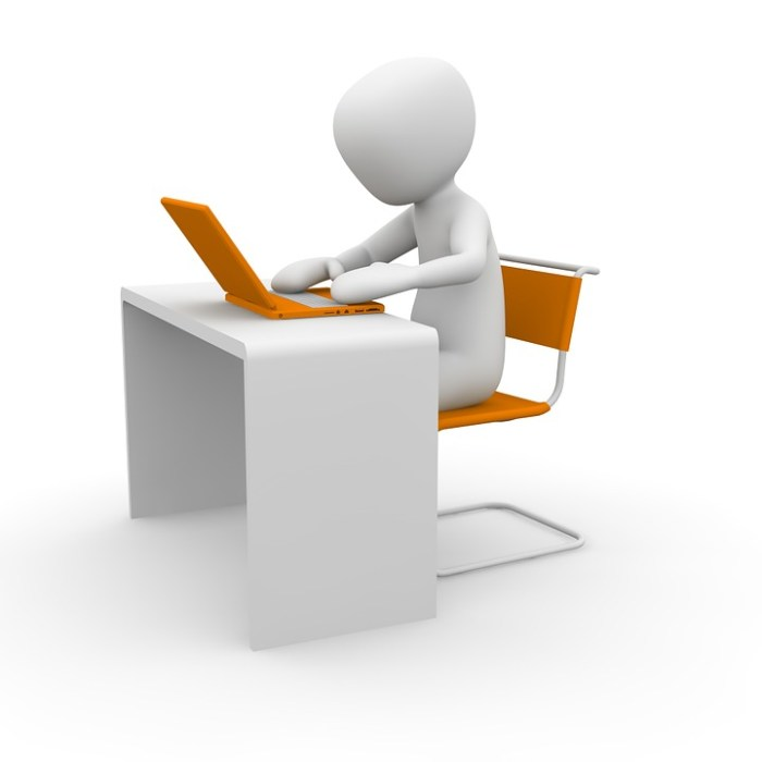 Person typing at desk