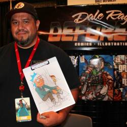 Dale Deforest stands at his booth at a comic con.