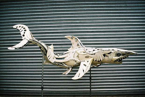 A Guy Turned Old Hubcaps & Rims into Magnificent Animal Sculptures