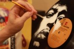 Stunning portraits of famous musicians painted onto old vinyl records