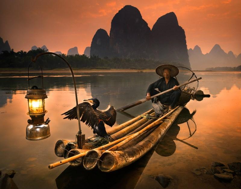 Cormorant Fisherman on the Li River, China by Michael Anderson