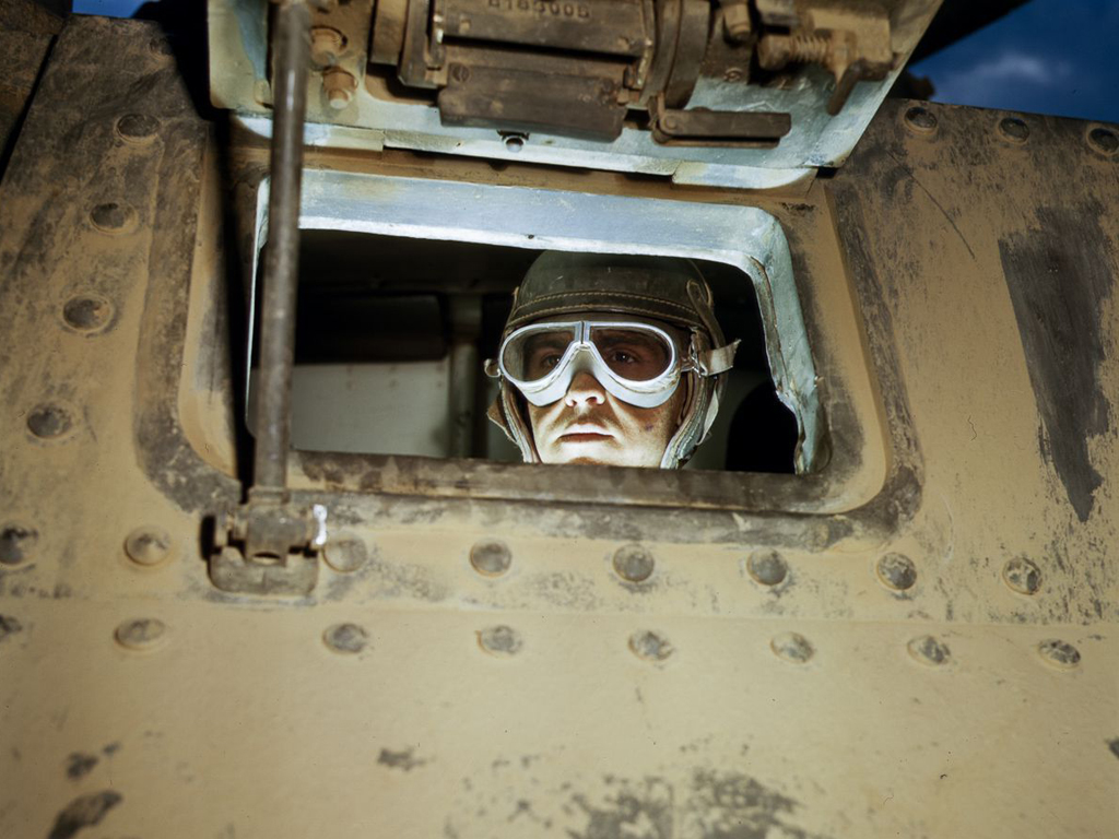Life at Fort Knox in 1942 - 1. A tank driver looks out of the front of his tank