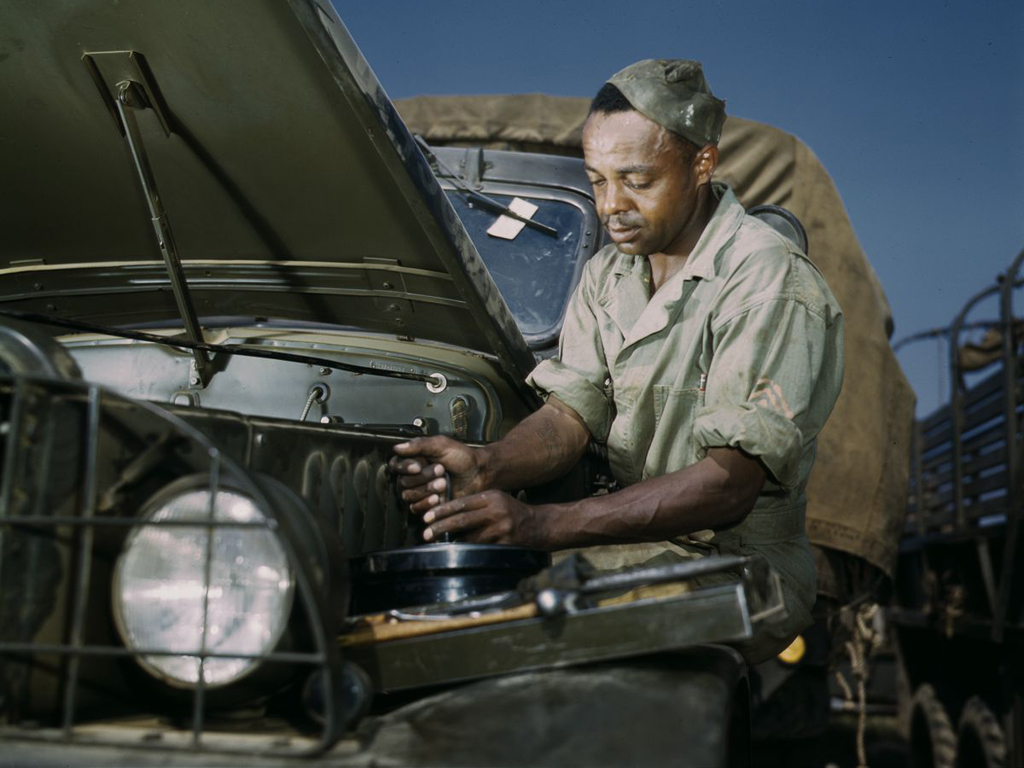 Life at Fort Knox in 1942 - 15. A mechanic tweaks a troop transport vehicle