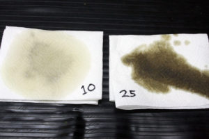 This is shot of a few drops of Joe Gibb's Driven BR15W-50 break-in oil drained from the oil pan after 10 full-throttle dyno runs, (left), and then after 15 more full-throttle dyno runs, (right). Notice how the oil's doing its job removing combustion contaminants from the engine (the reason it's darker). All new engines get fresh oil after the first 25 pulls on our dyno, and we cut open the oil filters to inspect for any debris. This motor's filter checked out ok.