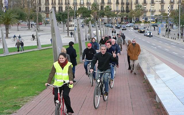 people riding bikes along street