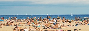 people on the beach in barcelona